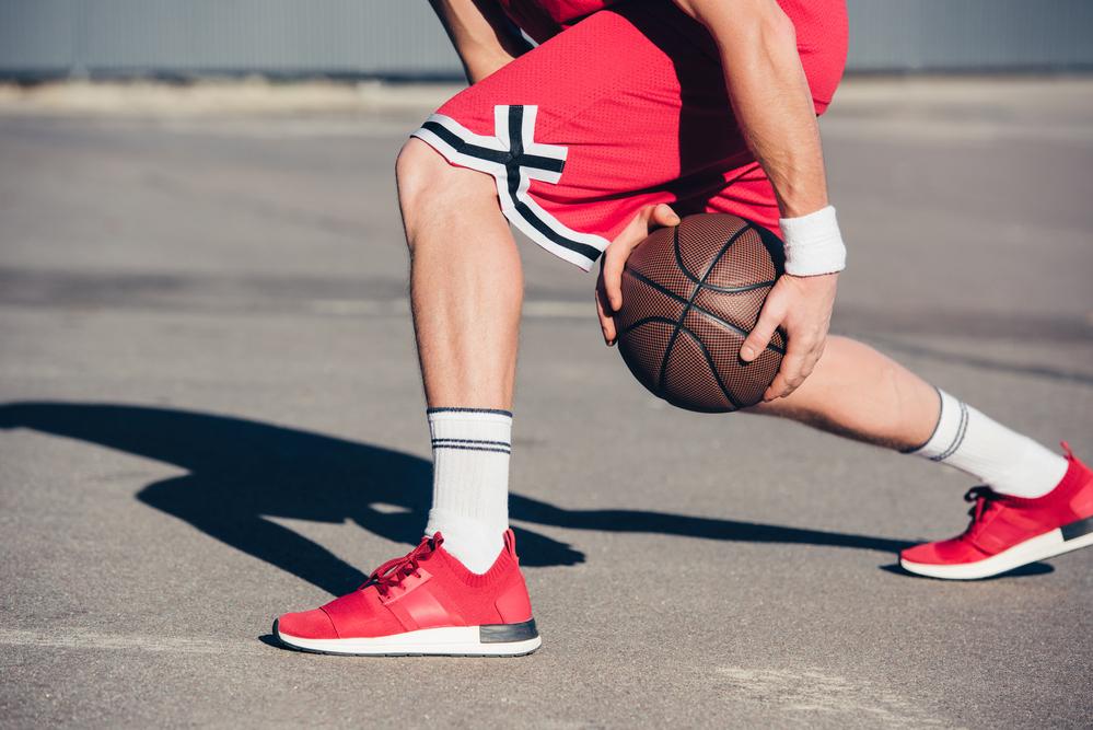 basketball player playing basketball on street