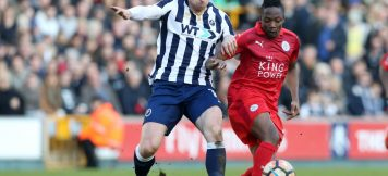 LONDON, ENGLAND - FEBRUARY 18: Ahmed Musa of Leicester City in action with Calum Butcher of Millwall during The Emirates FA Cup Fifth Round tie between Millwall and Leicester City at The Den on February 18, 2017 in London, England.