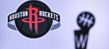 Houston Rockets Basketball club on the white screen. Silhouette of NBA trophy in foreground.