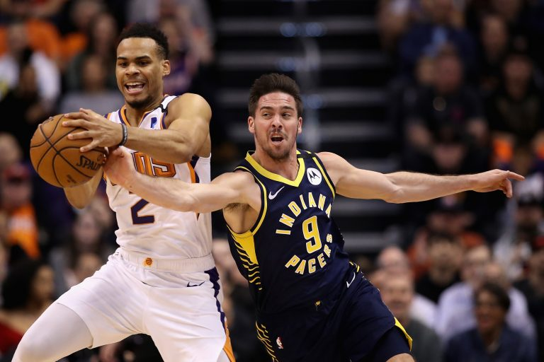 PHOENIX, ARIZONA - JANUARY 22: Elie Okobo #2 of the Phoenix Suns and T.J. McConnell #9 of the Indiana Pacers reach for a loose ball during the first half of the NBA game at Talking Stick Resort Arena on January 22, 2020 in Phoenix, Arizona. NOTE TO USER: User expressly acknowledges and agrees that, by downloading and or using this photograph, user is consenting to the terms and conditions of the Getty Images License Agreement.